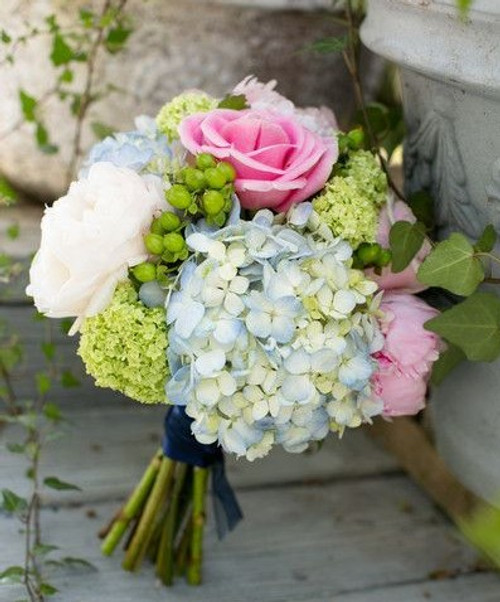 Simply beautiful bridal bouquet is a classic beauty feminine and perfect for any bride in any season.