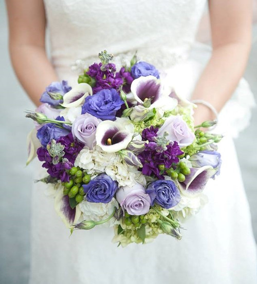 Gorgeous bridal bouquet with 4 different shade of purple with cream white & green accents.