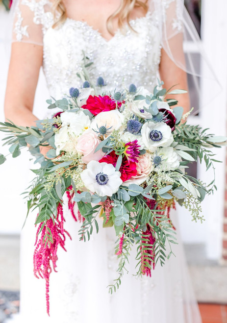 The Kristen Bouquet is fresh & modern with pops of bold color and loosely gathered greenery.