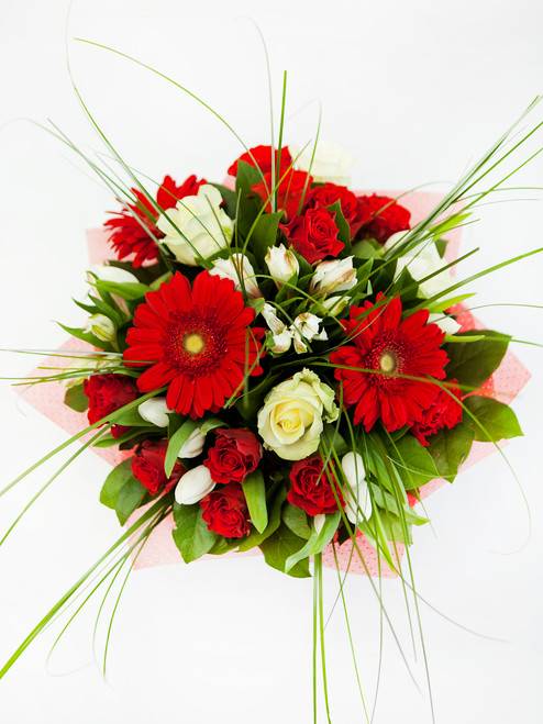 A beautiful bouquet of red & white blooms.