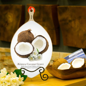 Artful iKamyu Coconut Grater w/Coconut Design - Safety cap is affixed on grater head when not in use. Displayed on an easel for easy access, when needed.