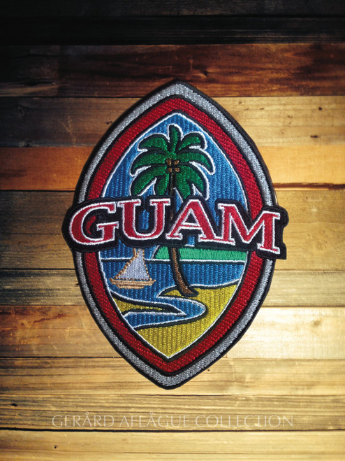 Embroidered Modern Guam Seal on Rustic Wood