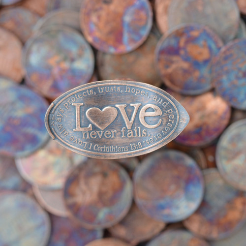 Pressed Copper Penny - Love Never Fails. Love always protects, always trusts, always hopes, always perseveres. 1 Cor. 13:7