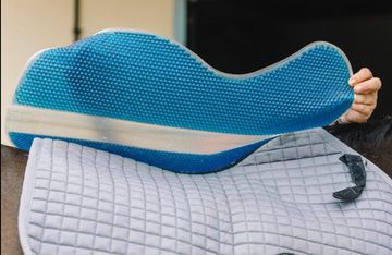 VIP Original in Blue placed above a traditional saddle pad with bobbles side down.