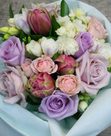 Soft Vintage style bouquet, seasonal blooms in pale pinks, whites and lavenders.   This is our all-time best seller.