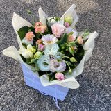 Seasonal pastel blooms arranged in a water filled box or bag.   This is a florist choice item, our team of professional florists will selected assortment of beautiful blooms from fresh seasonal flowers in a  pastel colour palette.
