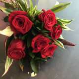Six red roses and foliage, comes in a complimentary vase.