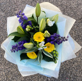 Freshly scented blues yellow and white seasonal flowers.
