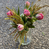 Petite Tulips and seasonal foliage in a vintage styled vase.  Delivery with tissue in a carry bag or box.