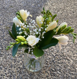 Petite freesias and foliage in petite vintage styled vase.   Presented in a gift bag or box.   Colours are florist choice and may vary depending on the availability.