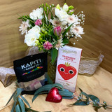 A vintage cottage posy with a Whittakers chocolate, a love heart and a pack of Kapiti sweets.