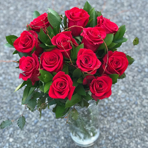 12 Roses with seasonal foliage, comes with a complimentary vase.