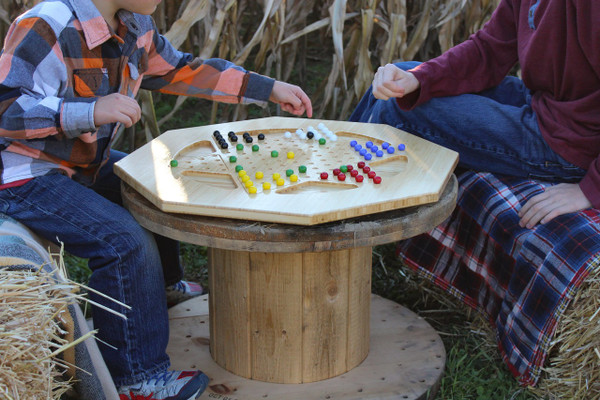 Family fun time playing Chinese Checkers