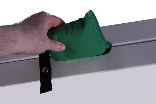 Cornhole bag storage within boards