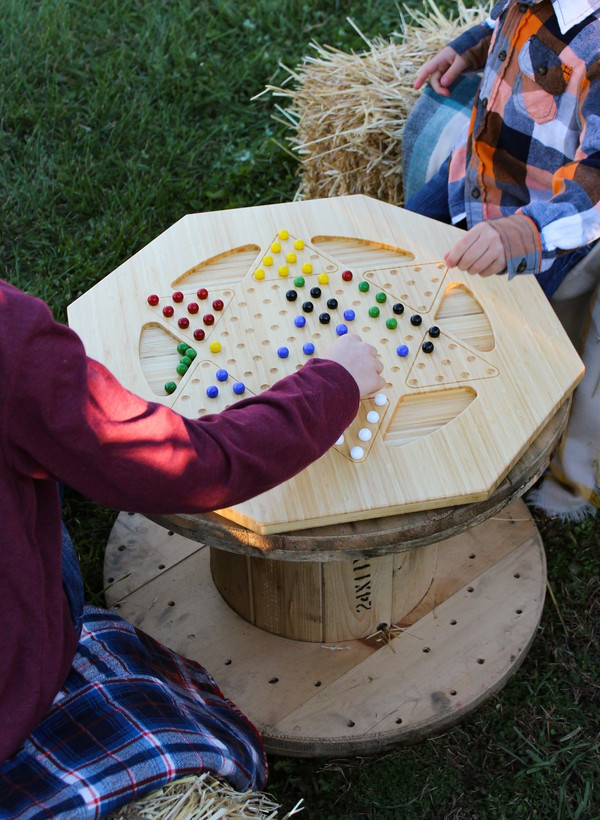 Family fun time playing Chinese Checkers with dad
