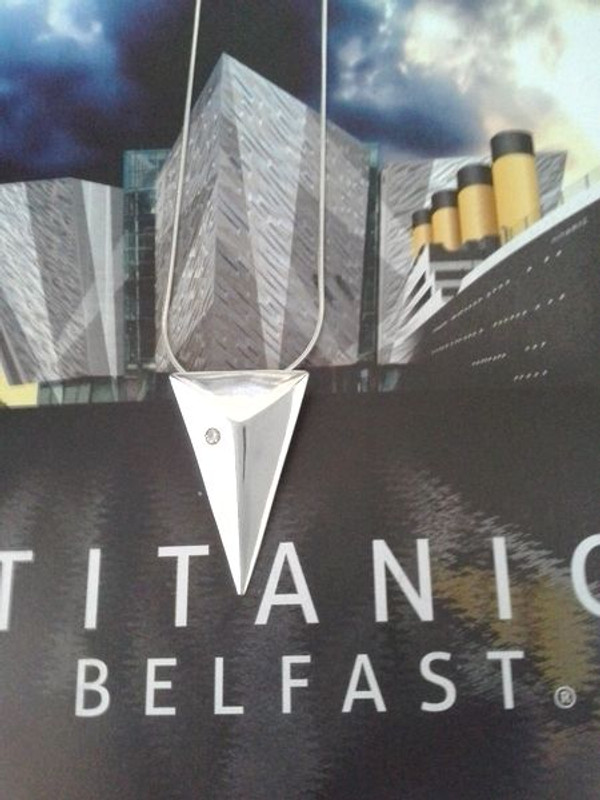 """TITANIC Solid """"BOW OF THE BOAT"""" in Sterling Silver with Cubic Zircon on a Sterling Silver Chain Front view."""