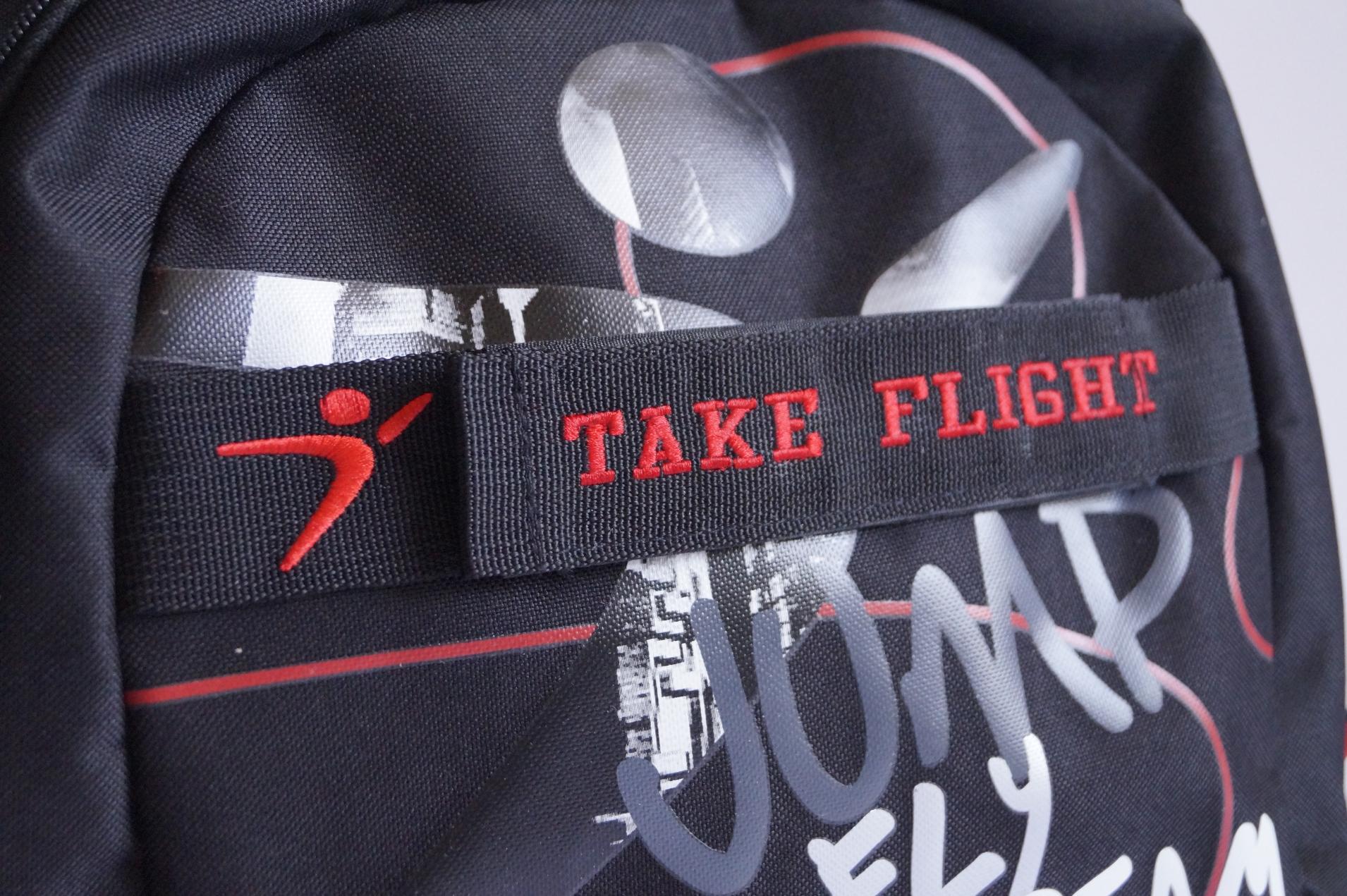 take-flight-dark-backpack-art.jpg