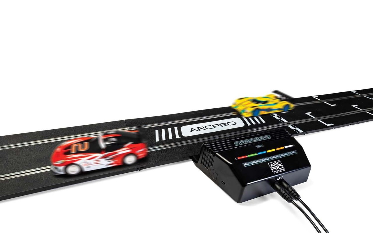Scalextric C8435 ARC PRO POWERBASE UPGRADE KIT • Transform any Scalextric set to ARC PRO • Multiple car racing (up to 6) • Plug in and play to transform your race with the ARC app • Comes with 2 x Wireless Controllers