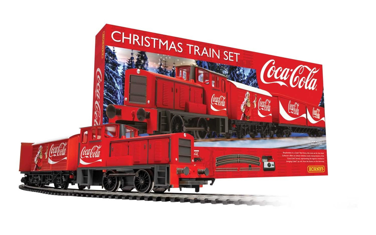 |Description Resplendent in a Coke® Red livery, this officially licensed train set for the Adult Collector offers an almost timeless iconic interpretation of the Coca-Cola® brand, representing the logistics involved in bringing Coke®, by rail, from the factory to the doorstep.  Ideal Starter Layout – Perfect For Christmas The Hornby Coca-Cola® Christmas Train Set offers the model railway enthusiast a brilliant and unique train set with an engine & wagons featuring the distinctive Coca-Cola® design and includes a good starter layout that can also be enjoyed by those new to the hobby and easily extended later.  Santa Enjoys a Coke Not only does the Coca-Cola® Christmas Train feature the iconic branding, but also the big man himself, a very jolly looking Santa Claus with rosy red cheeks, a big old smile and of course, a refreshing bottle of everyone's favourite soft drink, gloriously painted onto the side of the first wagon.  Train Around the Christmas Tree Christmas is a wonderful time of year and it always brings back those childhood memories and what better way to wake up on Christmas morning and see a Christmas Train Set running around the Christmas tree. With this set you can create a whole new set of magical memories for the whole family to enjoy for years to come.  What's more, you can extend your Christmas Train by coupling the annual Hornby Christmas Plank Wagon 2019 which features the Hornby branding with Christmas wishes printed on the side and quite literally bursting at the seams with presents.  Hornby Christmas Plank Wagon, 2019  What's in the Box The Hornby Coca-Cola® Christmas Train Set includes a OO Gauge (1:76 Scale) railway oval track layout designed to fit a space of 1100mm x 1070mm.  The set includes the following: -  - 0-4-0 Diesel Shunter with Coca-Cola® Branding - Closed Box Van with Coca-Cola® Branding - Container Wagon with Two Containers Featuriing the Coca-Cola® Branding - Oval of Track - Controller - Re-Railing Tool – To help you easily place the trains on the track     Extending Your Christmas Train Set If you're looking to extend your new Christmas Train Set, Hornby offer several great value extension packs, allowing you to add more detail or complexity to your layout such as sidings or stations for shunting and more.  Extension Pack A is the ideal first extension to consider for most beginners, or you can view all the available extensions here. FOR ADULT COLLECTORS ONLY