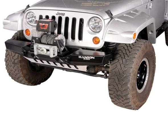 """The width of this midsize bumper extends to about the middle of the fender. This gives the bumper a sporty look with ample protection and approach angles for off road use and allows for maximum wheel clearance and good fender protection. It's handcrafted from 3/16"""" cold-rolled steel. Multiple angles are used in the construction for optimum approach and departure angles. The 2"""" dropped winch deck accommodates most winches and allows for better airflow to radiator and a lower center of gravity. The multiple angles and the dropped winch deck combined give the bumper superior strength. The unique placement and design of the 1"""" wide clevis tabs gives them unmatched strength allowing them to be pulled from any angle without fear of damage to bumper or tab, and do not interfere with approach and departure angles. Tab is drilled for a 7/8"""" pin. Bumper provides accommodation for factory driving or after market lights. The well-known value and quality of a Hanson product is exemplified in this handcrafted bumper. It comes in a black semi-gloss powder coat. NOTE: Fairlead Mount Plate, Fairlead, Winch, Off-Road Lights, Recovery Shackles and straps are NOT included with the bumper."""