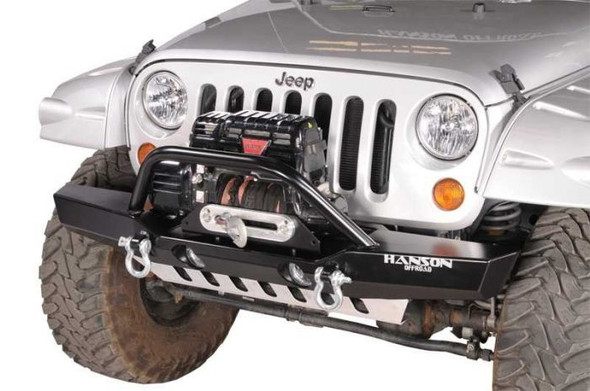 """The width of this midsize bumper extends to about the middle of the fender. This gives the bumper a sporty look with ample protection and approach angles for off road use. Provides additional protection for the winch. The robust design allows for excellent wheel clearance and good fender protection. It's handcrafted from 3/16"""" cold-rolled steel. Multiple angles are used in the construction for optimum approach and departure angles. The 2"""" dropped winch deck accommodates most winches and allows for better airflow to radiator and a lower center of gravity. The multiple angles and the dropped winch deck combined give the bumper superior strength. The winch bar is constructed of 1 ¾"""" diameter x .120 wall tubing and is angled forward and welded for strength. The unique placement and design of the 1"""" wide clevis tabs gives them unmatched strength allowing them to be pulled from any angle without fear of damage to bumper or tab, and do not interfere with approach and departure angles. Tab is drilled for a 7/8"""" pin. Bumper provides accommodation for factory driving or after market lights. The well-known value and quality of a Hanson product is exemplified in this handcrafted bumper. It comes in a black semi-gloss powder coat. NOTE: Fairlead Mount Plate, Fairlead, Winch, Off-Road Lights, Recovery Shackles and straps are NOT included with the bumper."""