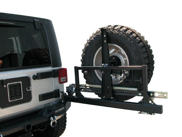"CARGO BASKET COMPATIBLE! Bumper is made of 3/16"" steel, that is laser cut and formed. It has a drop down deck in it to allow the rear tire to be mounted lower. It also has a built in 2"" class 2 receiver for hauling and towing. The tire carrier is all new and similar to our TJ square frame unit. It features a 3/16"" upper latch plate that mounts to the tailgate and will accept all Hanson cargo packages! The tire carrier, carries a 37"" tire with no problems or rattles. It will carry a 48"" HiLift as shown in the picture. Tire carrier opens very easily. It uses a bear claw latch very similar to a car door latch, gentle pull release lever the unit unlocks and is ready to open."