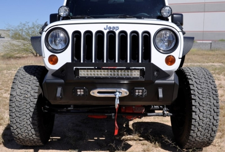 """The Jeep JK Flexible Bumper System, allows you to create a bumper that suits your lifestyle, whether it be Rock Crawling, Mall Crawling or Desert Romping. See all of the available Top Hoops and Side Caps.2007 - 2013 Jeep JK Stealth Fighter Front Bumper Center w/Tow Hooks and Flush Mount holes for LED Lights. Fits up to a 12k lb. winch, comes with standard flat ends and bolts directly to the frame without any interference to airbag sensors. Tow Hooks allow for ease of towing, as well as recovery.Features:.120"""" Wall Steel Tube ConstructionLaser Cut Skid plates, Tabs and Plates for a Precise FitDirect fit - No Cutting or Welding requiredStainless Steel Hardware**2013 and Newer models require the vacuum pump to be relocated****Winch Plate Limit is 10,500 lbs., use only winches at or under this approved pull rate to retain Bumper Warranty."""