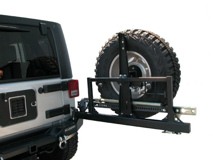"""CARGO BASKET COMPATIBLE! Bumper is made of 3/16"""" steel, that is laser cut and formed. It has a drop down deck in it to allow the rear tire to be mounted lower. It also has a built in 2"""" class 2 receiver for hauling and towing. The tire carrier is all new and similar to our TJ square frame unit. It features a 3/16"""" upper latch plate that mounts to the tailgate and will accept all Hanson cargo packages! The tire carrier, carries a 37"""" tire with no problems or rattles. It will carry a 48"""" HiLift as shown in the picture. Tire carrier opens very easily. It uses a bear claw latch very similar to a car door latch, gentle pull release lever the unit unlocks and is ready to open."""
