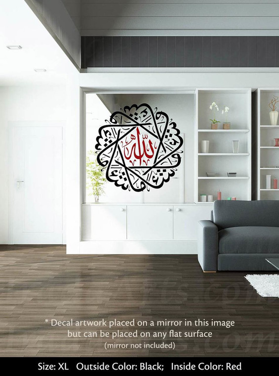 "A black & red ""Masha'Allah"" decal placed on a mirror."