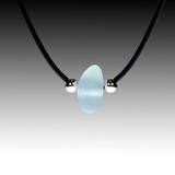 "Grey sea glass on black rubber, 16"" necklace."