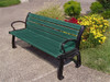 green recyled plastic park bench with colorful flowers behind it