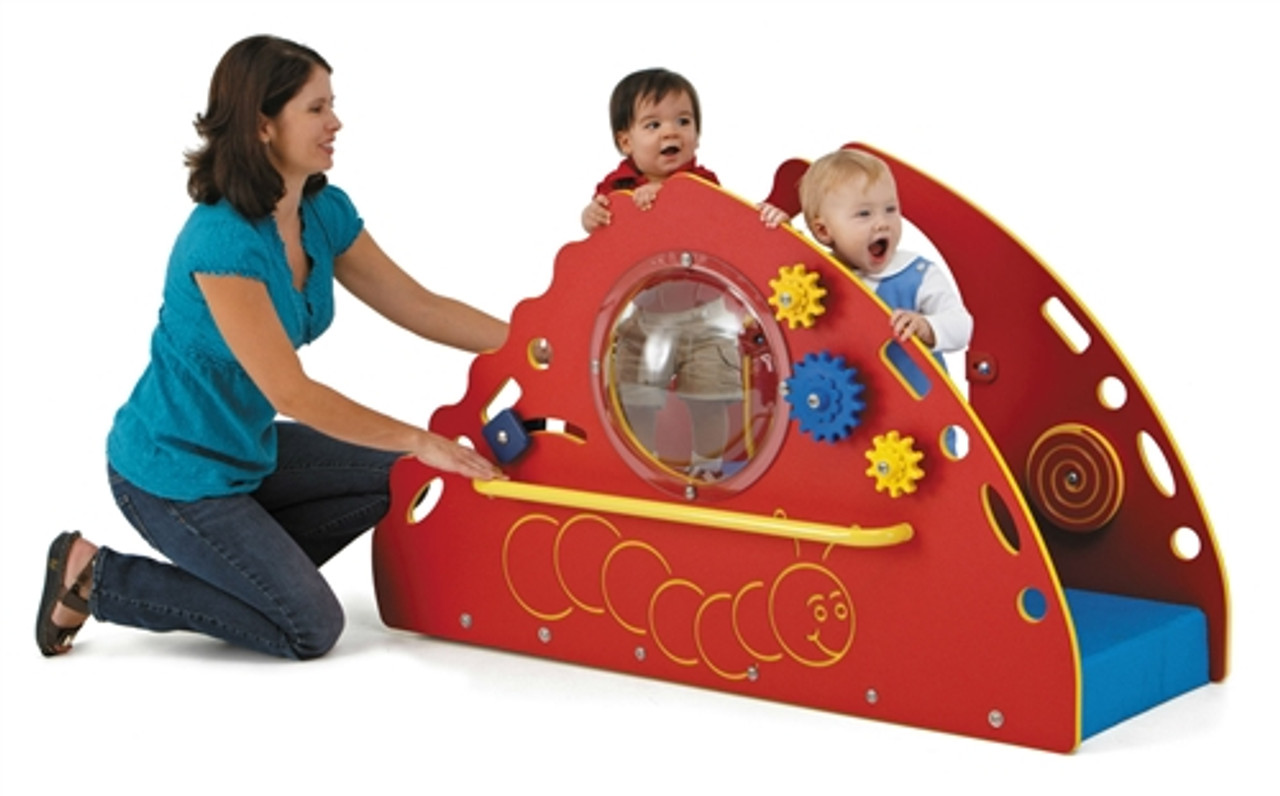 woman playing with 2 children who are on a small playset