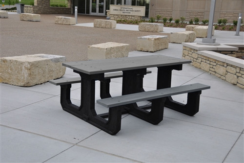 recycled plastic picnic table in a stone courtyard