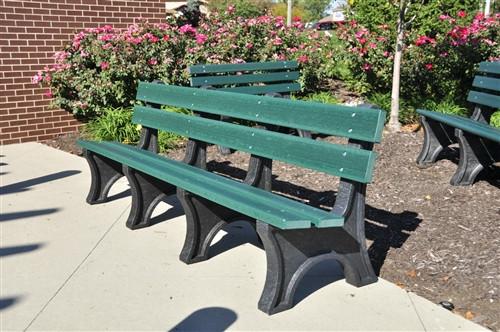 green recycled plastic bench on sidewalk