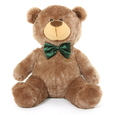 He is a cheerful Christmas teddy bear with mocha brown fur and a smile that will melt snow!