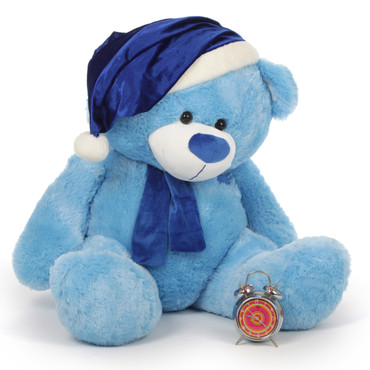 35in Marty Shags Christmas Teddy Bear adds a beautiful blue touch to Christmas with blue fur wearing a blue teddy bear Santa hat and blue scarf