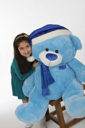 Marty Shags is 45 inches of beautiful blue Christmas Teddy Bear in a blue Santa hat and scarf