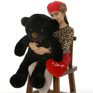 30in Juju Cuddles is a soft cutie with black fur and a plush red I Love You heart