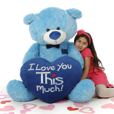 "Marty Shags is a sweet light blue bear with a huge ""I Love You This Much!"" royal blue plush heart – 52in"