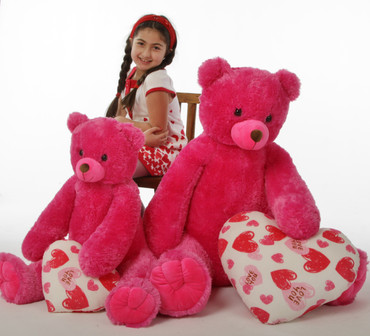 "Cherry Tubs is a hot pink sweetheart, 42in and 2 styles of heart pillows - ""Love You"""