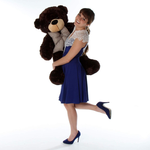 over 3ft tall huggable brown teddy bear and is so soft and cuddly