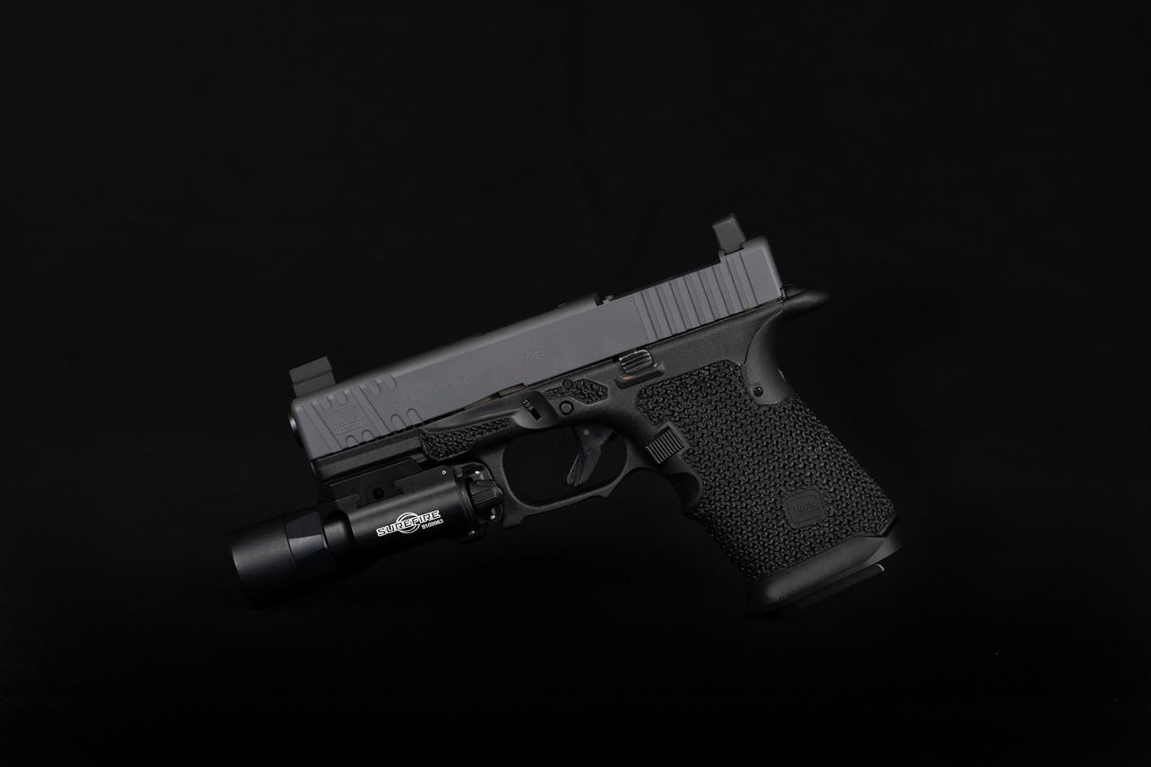 Basic/EDC serrations with an RMR optic cut- Sniper gray cerakote   Elite Grip work