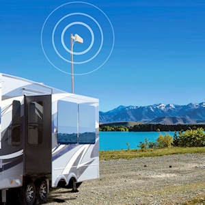 weBoost Connect RV 65 outside LPDA deployed behind a fifth wheel at a mountain lake