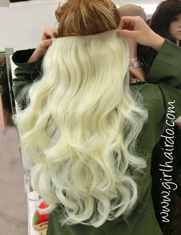 blonde hair extensions taken under different lighting ( normal room lighting )