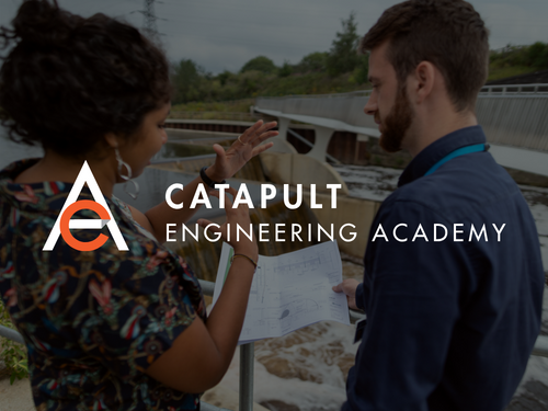 Catapult Engineering Students Looking at Document