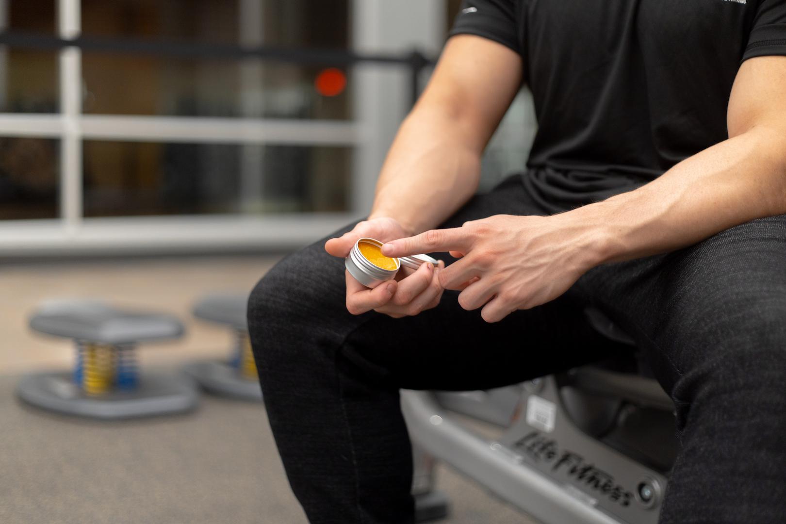 Man using CBD muscle rub