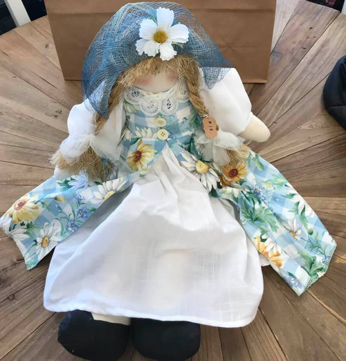 Doll in Yellow and Blue Daisy Dress