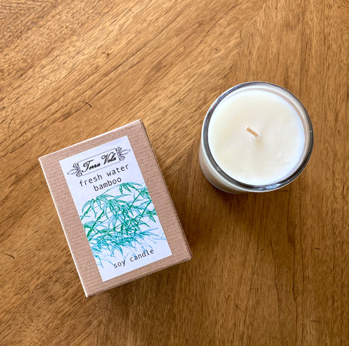 Freshwater Bamboo Natural soy wax candle, hand poured in small batches. An artisan soy wax candle of the highest quality. This unique fragrance blend begins with top notes of fresh lime, mint, and ozone; balanced with middle notes of French lavender and oakmoss, finishing its well-rounded bouquet with a base of white musk.