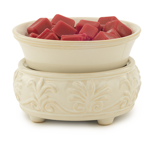 This Sandstone 2-in-1 Fragrance Warmer is accented by a pattern of fleur de lis and palmettes. Simply add wax melts to the dish, or remove the dish and place the candle jar directly on the warming plate. Turn it on, and enjoy your favorite fragrance as it spreads through the room.