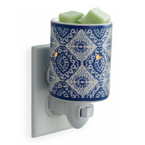 White porcelain provides the canvas for an intricate hand-drawn pattern in a striking blue.